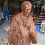 Realization of the statue of San Francesco and the wolf for the gardens of Carbonana.